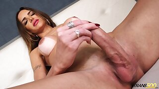 Sex-crazy transsexual Jennifer Satine is jacking off hard and big cock