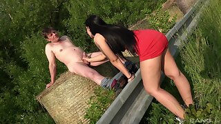 Brunette hottie drops on her knees to jerk off an experienced man